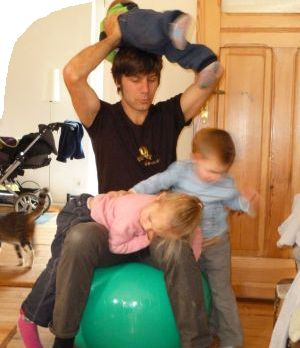 Daddy with kids playing with gym ball