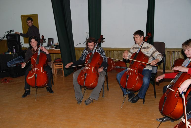 boys in a circle learning cello