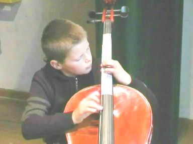 boy placing fingers accurately on cello-fingerboard
