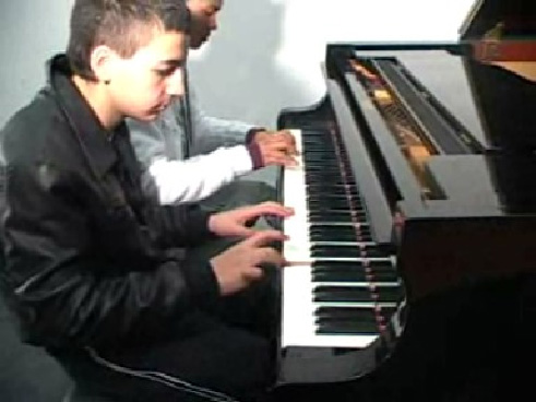 music as a sport neurodidactic brain-based method migrant boys playing piano
