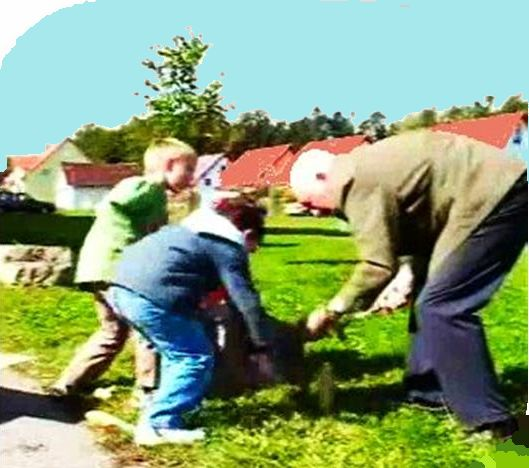 boys working enthusiastically with grandpa